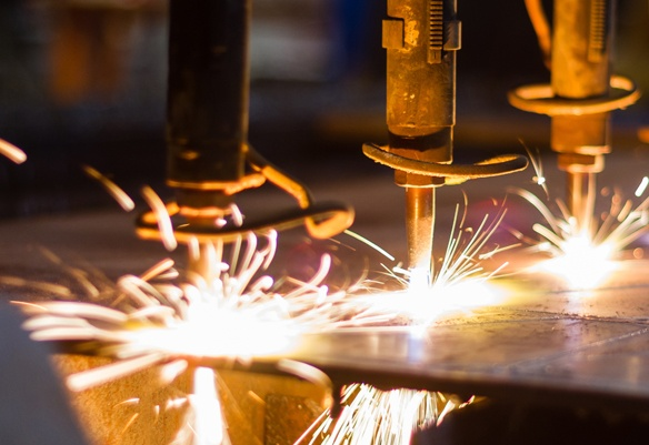 Machinery working on metal in mass production