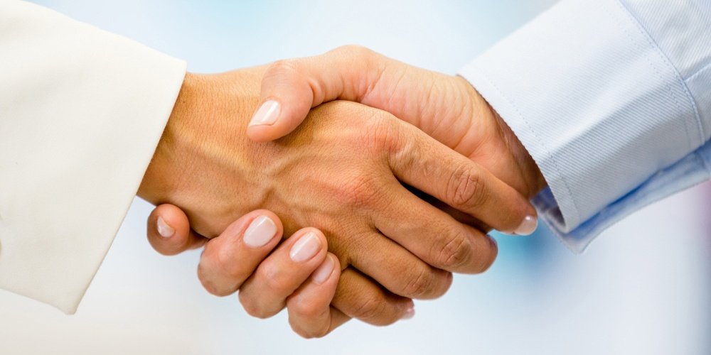 Business handshake closing a deal at the office-1.jpg