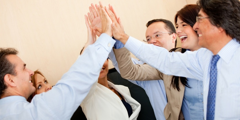 Group of business people giving a high-five-1.jpg